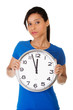 Happy young woman holding clock