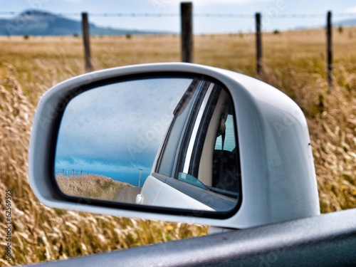 road in the car mirror