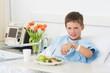 Boy having healthy food in hospital