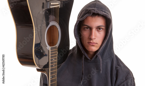 closeup of a young musician with his acoustic guitar. Selective