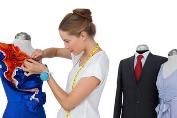 Female fashion designer and mannequins