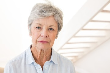Retired woman frowning at the camera