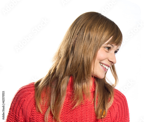 Young pretty blonde girl over white background