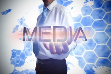 Businessman presenting the word media