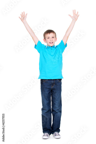 Happy boy with raised hands up.