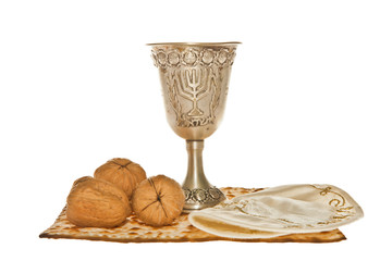 Matzoth, silver Kiddush cup  walnuts and Yarmulke for Passover
