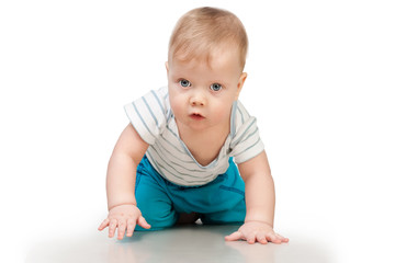 Baby boy crawling isolated on white