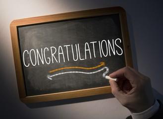 Hand writing Congratulations on chalkboard