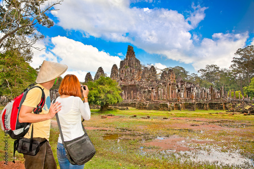 Couple at  Prasat Bayon temple,  Angkor Thom, Cambodia.