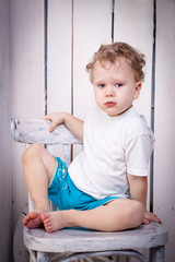 Portrait of boy on chair