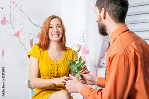 Man giving a rose to girl on Valentine`s day