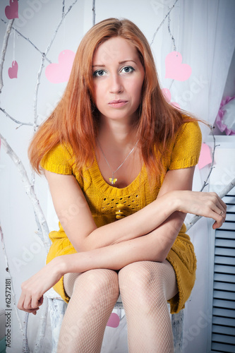 Portrait of a young attractive woman sitting on the chair