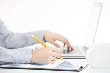 Business woman analyzing investment charts with laptop