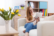 Attractive woman using digital tablet on sofa