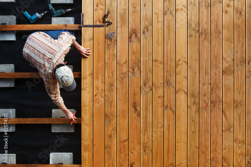 canvas print picture Constructing a wooden patio