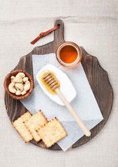 Chopping board of Cheese camembert  and Honey