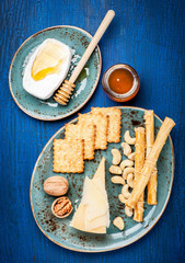 Parmesan, Camembert cheese, honey,  grissini bread sticks.