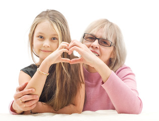 grandmother and granddaughter show hands-heart gesture