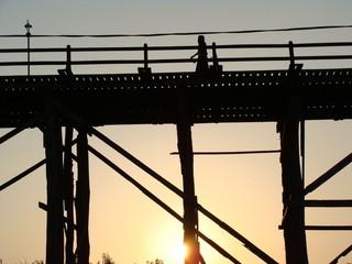 Mon bridge Kanjanaburi Thailand in silhouette