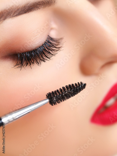 Woman eye with beautiful makeup and long eyelashes. Mascara
