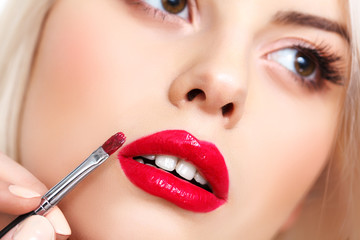 Woman Eye with Beautiful Makeup. Red Lips.
