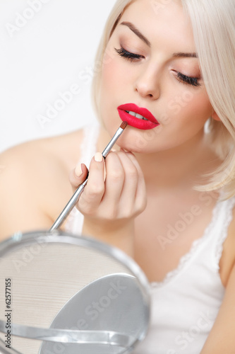 Makeup Applying. Beautiful Woman doing Daily Makeup. Cosmetic
