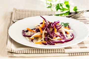 Healthy salad with green, red cabbage and carrot