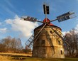 Old wind mill house in spring sunny day