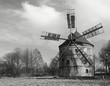 Old wind mill house in spring sunny windless day.