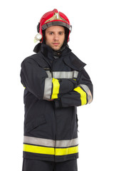 Serious firefighter posing