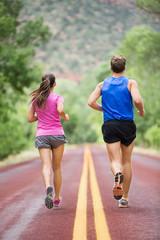 Running training runners jogging on road