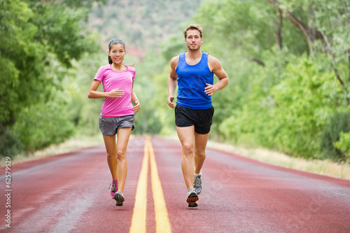 Fitness sport couple running jogging - 62579529