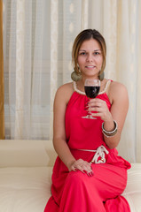Beautiful woman laughing over a good glass of wine