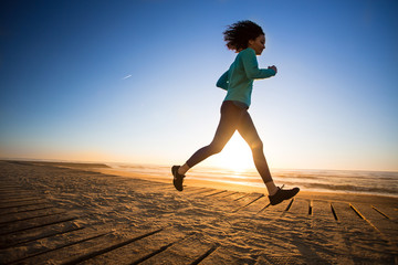 Afro woman running