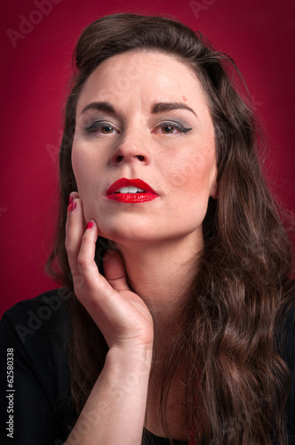 Woman Portrait Against Red Background