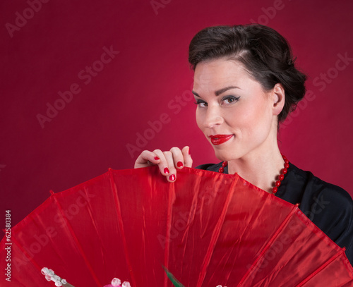 Pinup Girl Looks Over Red Parasol