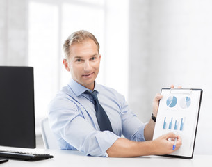 businessman showing graphs and charts