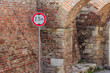 Traffic sign for low clearance in front of brick wall