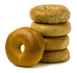 Stack of Four Bagels with OneLeaning on the Side