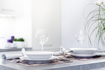 Set of dinner plates in modern kitchen