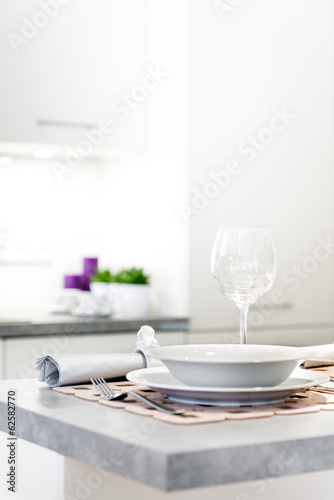 Modern kitchen interior with glass and plate