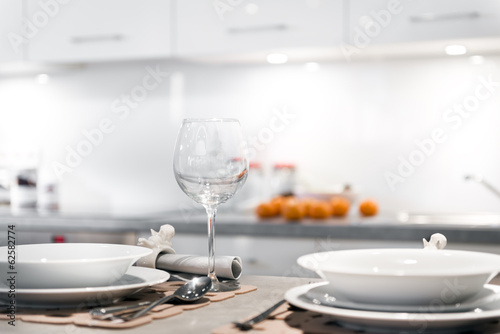 Modern kitchen with glass and plates