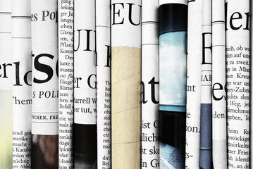 Close-up of folded newspapers