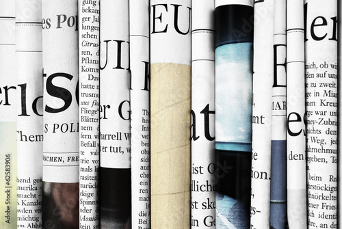 Close-up of folded newspapers - 62583906