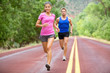 Athletes running - sport couple jogging in summer