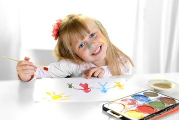 little blonde girl painting and drawing family