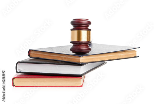 Judge's gavel on red legal book