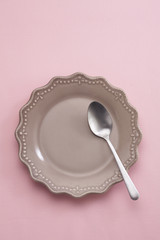 spoon and dish on pink fabric