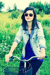 Beautiful young woman and a bike