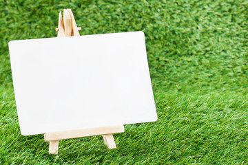 White paper on Grass background